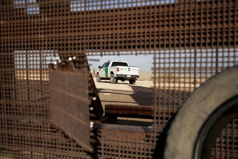 Biden under fire for border wall cash freeze