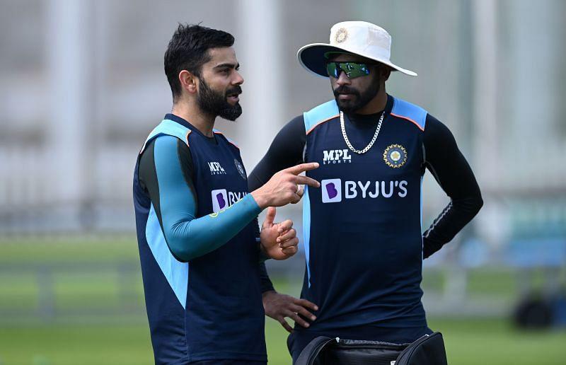 Mohammed Siraj (right) speaks to captain Virat Kohli during a net session at Lord