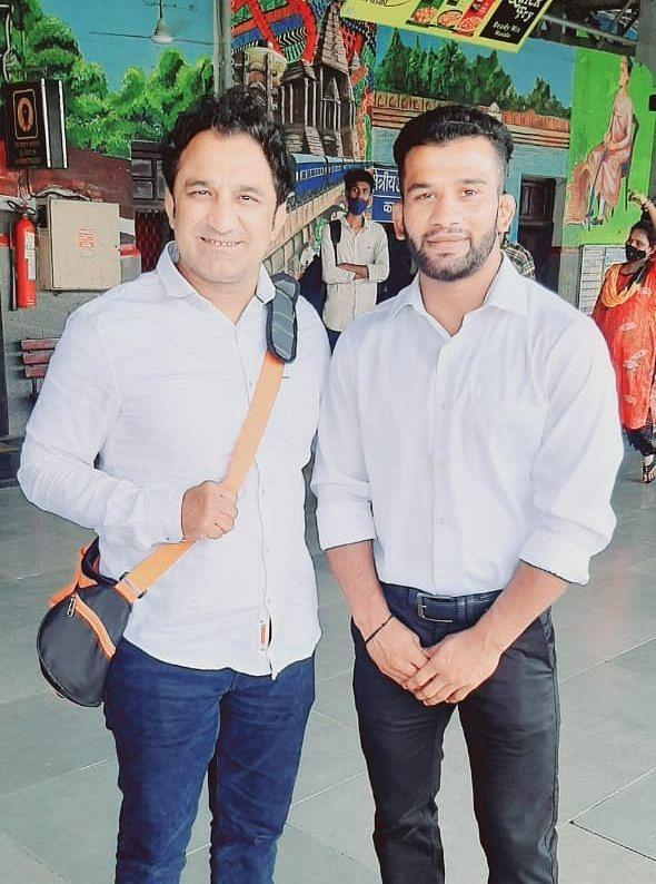 Sunny Jadhav (R) with Railway wrestling coach Kripa Shankar Patel