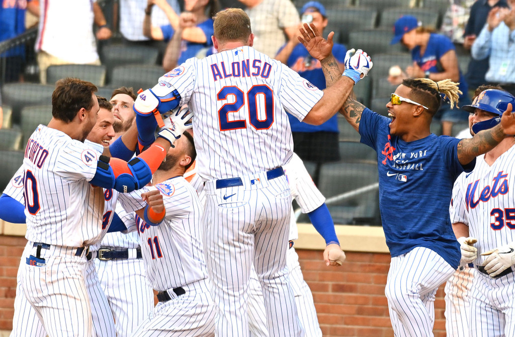 Pete Alonso celebrates with his teammates after hitting the game-winning homer in the seventh inning of the Mets