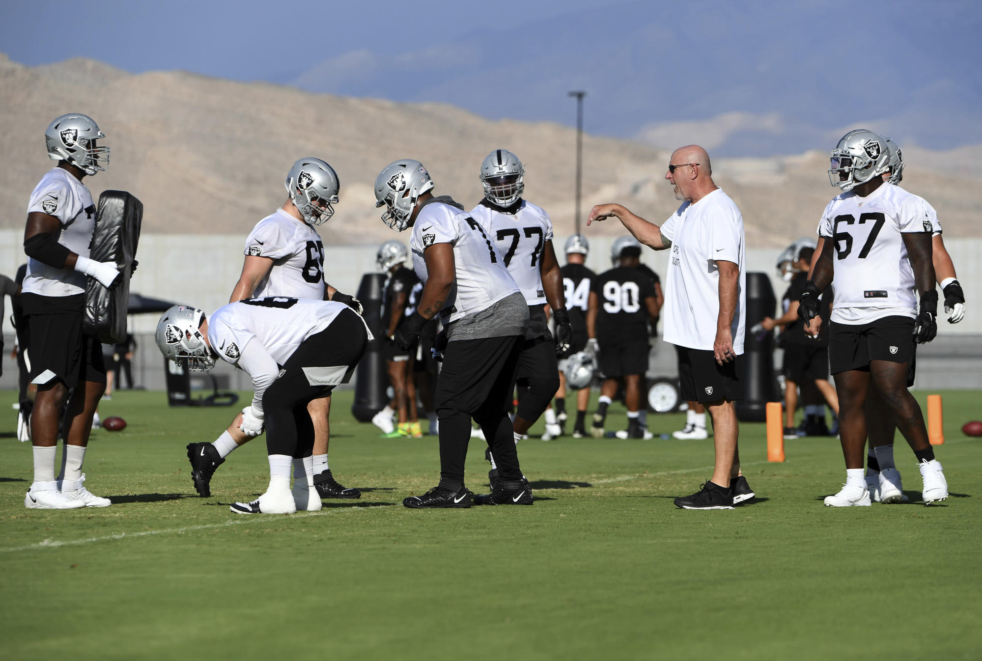 Raiders' rebuilt offensive line coming together in camp