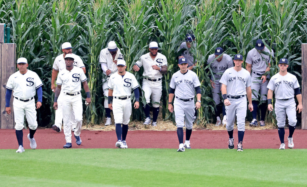 """Yankees and White Sox players come out of the cornfield before the """"Field of Dreams"""
